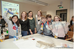 The PlasticFreeDanube Teamm together with children in front of a table with sortet plastic waste