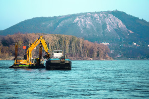 Dredging ship on the river bed