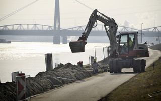 dredging works at the danube riverside in Linz